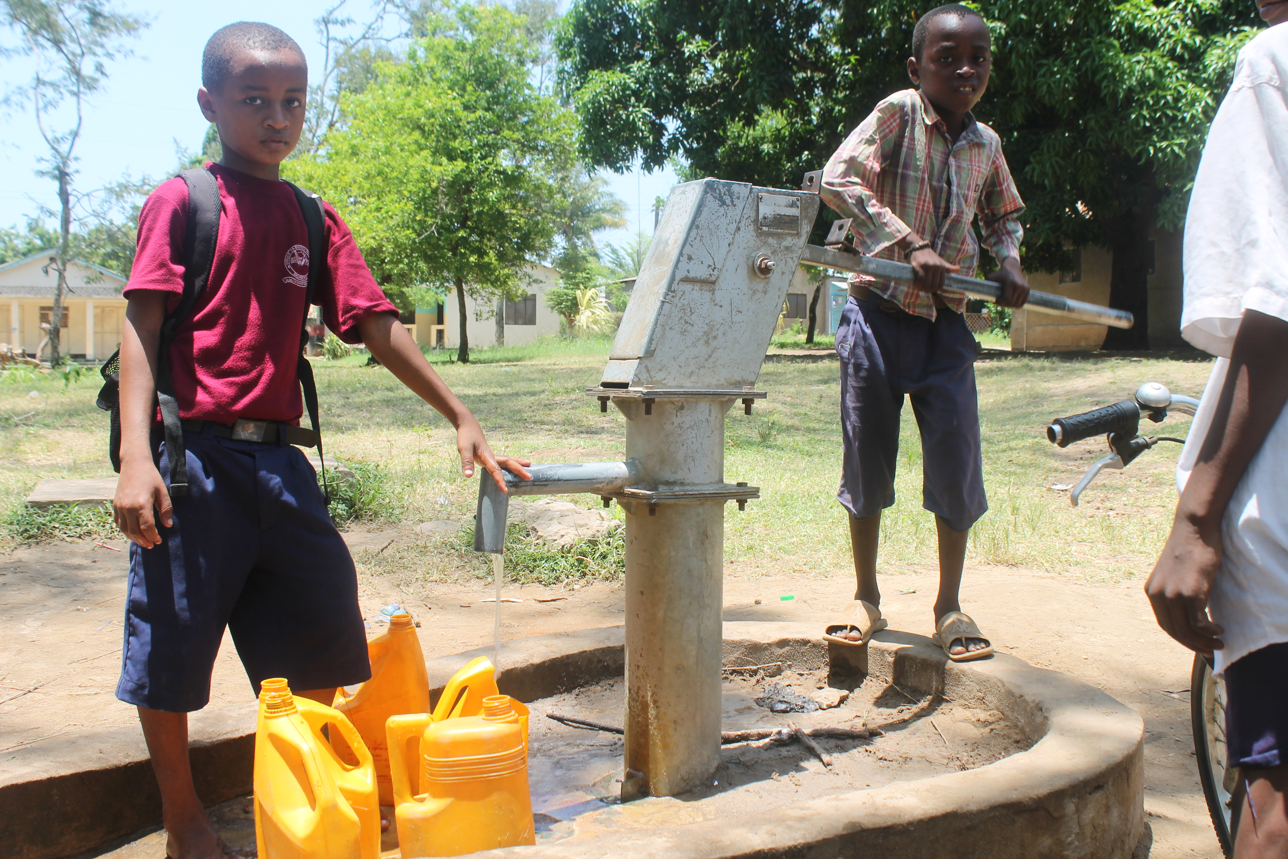 children-gathering-water-at-well